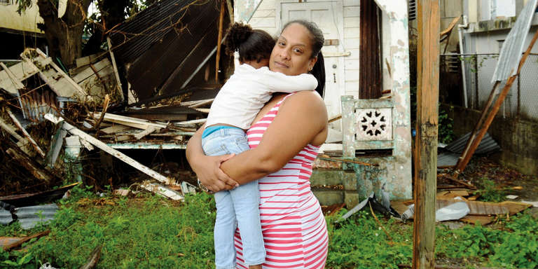 A mother hugs her daughter tightly as they cope with the aftermath of Hurricane Maria. Photo credit: Rebecca Zilenziger/Save the Children, September 2017.