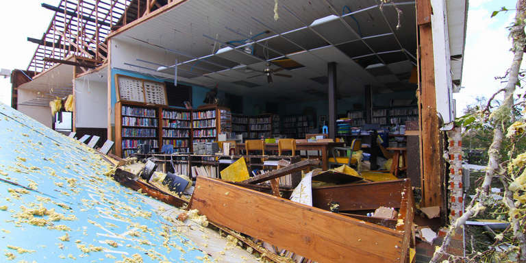 Destruction from Hurricane Michael, 2018, which hit the Florida panhandle and devastated nearby communities in Florida, Georgia and the Carolinas. This photo depicts The Kinard Branch Library in Wewahitchka that sustained detrimental damage. Photo credit: Gordon Folkes, Save the Children. October 2018.