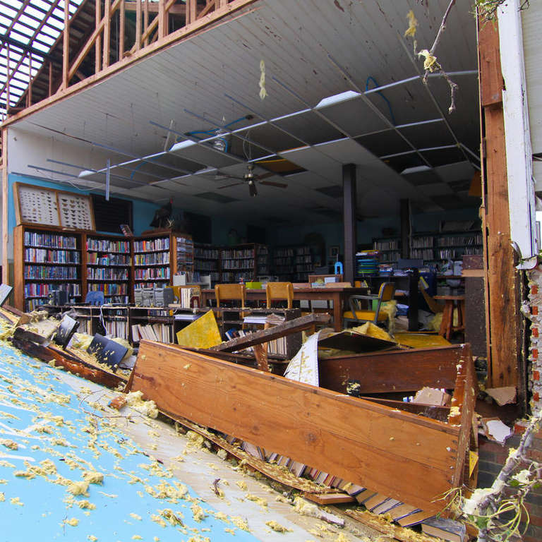 Destruction from Hurricane Michael, 2018, which hit the Florida panhandle and devastated nearby communities in Florida, Georgia and the Carolinas. This photo depicts The Kinard Branch Library in Wewahitchka that sustained detrimental damage. Photo credit: Gordon Folkes / Save the Children, October 2018
