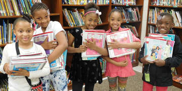 Children in US Programs receive books donated by American Girl. Save the Children, March 2018