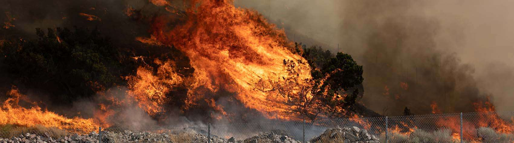 A wildfire spreads across a region in California.