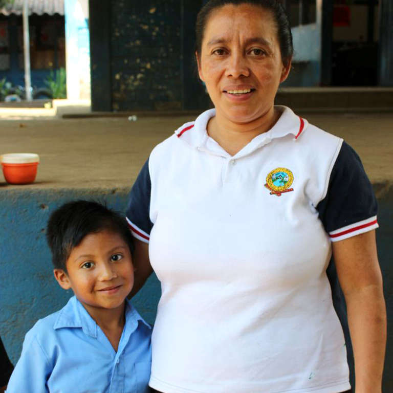 Ricardo with his mother Yeni are both benefitting from sponsorship programs in El Salvador. Photo Credit: Save the Children in El Salvador