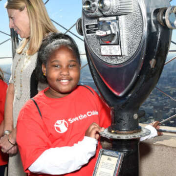 Miracle, a sponsored child from South Carolina, is shown here at the top of the Empire State Building. She was chosen to participate in a Day of the Girl event with Save the Children. Photo credit: Save the Children, 2017.