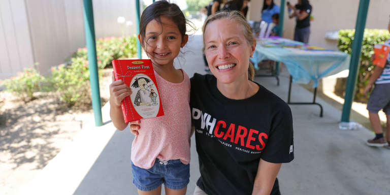 PVH associate Lisa with a child in our SummerBoost program at Washington-Reedley Elementary School in Central West Valley, California. Photo credit: Save the Children, July, 2017.