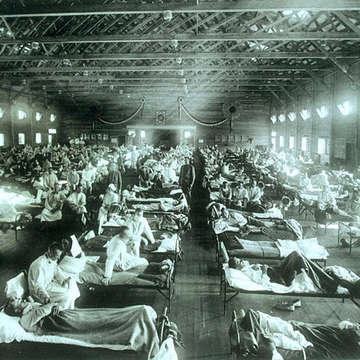 This image from Wikimedia Commons, sourced from Pandemic Influenza: The Inside Story, depicts an row after row of patients in beds at an emergency military hospital in Camp Funston, Kansas, during an influenza epidemic in 1918 or 1919. Image credit: courtesy of the National Museum of Health and Medicine, Armed Forces Institute of Pathology, Washington, D.C., United States.
